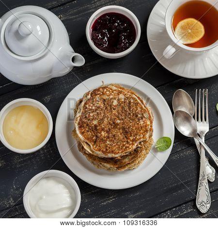 Healthy whole wheat pumpkin pancakes on a ceramic plate