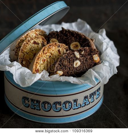 Chocolate Biscotti With Hazelnuts In Vintage Metal Box On A Dark Wooden Surface