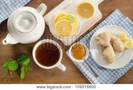 Teapot And Cup Of Tea With Lemon, Ginger And Mint