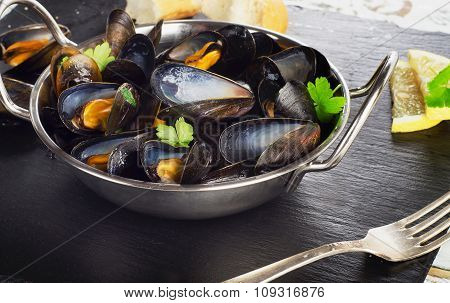 Boiled Mussels In Cooking Dish On A Dark Background.