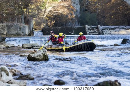 Adventurous Group Doing White Water Rafting The Rapids Of River Voidomatis In Konitsa