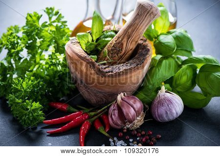 Fresh Herbs And Spices In Wooden Mortar