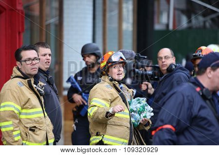 Female FDNY firefighter outside building