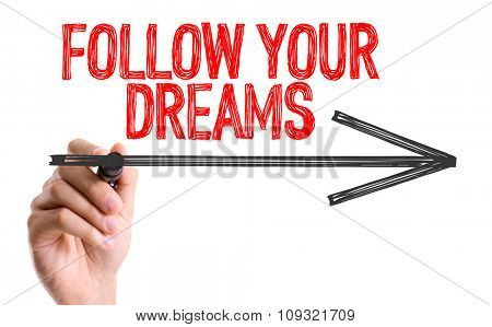 Hand with marker writing: Follow Your Dreams
