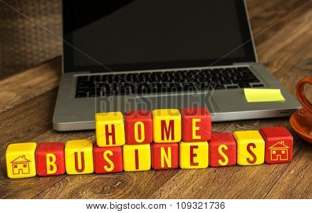 Home Business written on a wooden cube in a office desk