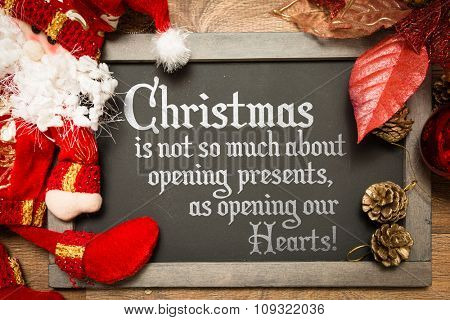 Blackboard with the text: Christmas is not so much about opening presents, as opening our Hearts