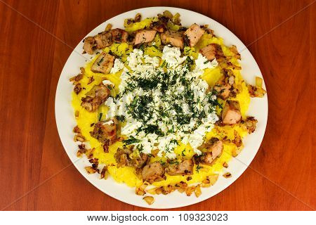 Polenta With Meat And Homemade Cheese On Plate, Top View
