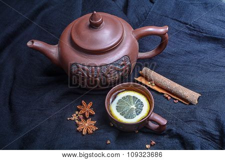 Chinese Teapot With Small Cups And Spices