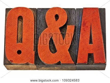 Q&A - questions and answers acronym - isolated text in vintage letterpress wood type stained by red ink