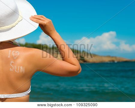 Woman In White Hat Against Sea Background. Space For Text.
