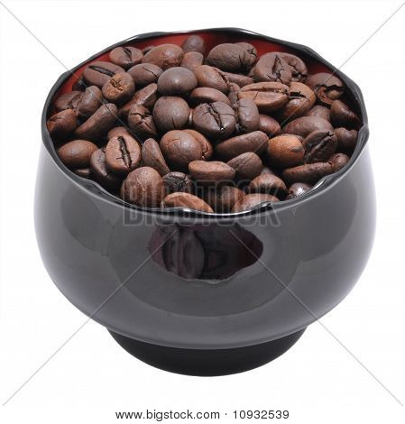 Grains Of Coffee Are In A Cup
