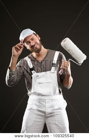Attractive Bearded Young Painter With Paint Roller