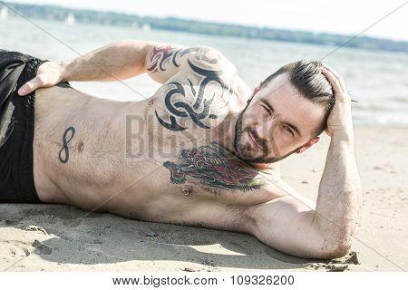 sexy man with tattoo