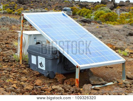 PITON DE LA FOURNAISE, REUNION ISLAND, FRANCE - NOVEMBER 6, 2015: Measuring instrument for earthquake forecast. Scientific equipment on a currently one of the most active volcanoes in the world.