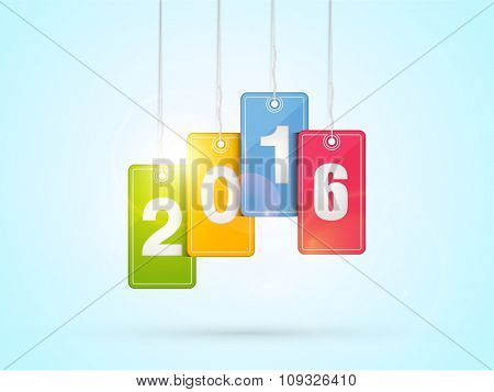 Stylish text 2016 on glossy colorful hanging tags for Happy New Year celebration.