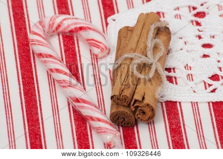 Christmas Candy Cane. Cinnamon Sticks. On Red White Napkin