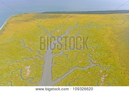 Colorful Estuary On A Remote Coast Seen From Above