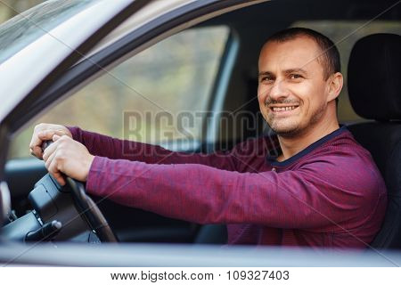 Happy Man Behind The Wheel Of A New Car