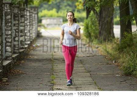 Young sports girl during Jogging.