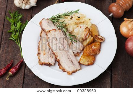 Roasted bacon or pork belly with potato and sauerkraut