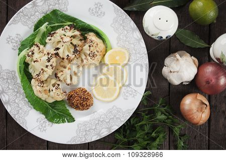 Grilled cauliflower with lemon slices, healthy vegetarian meal