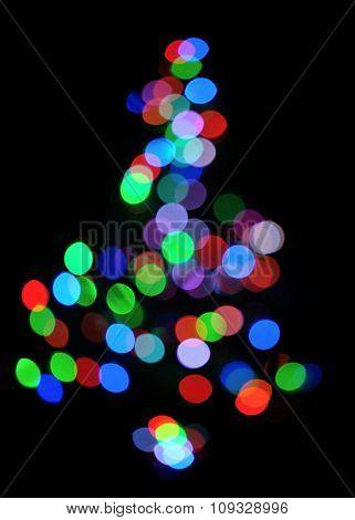 glowing christmas tree on black