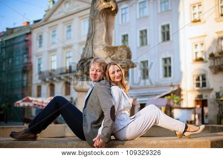 Pretty sunny outdoor portrait of young stylish couple