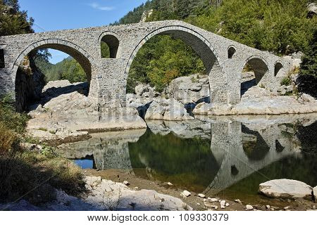 Reflection of Devil's Bridge in Arda river, Kardzhali Region