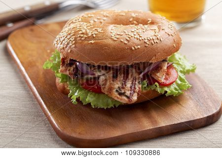 Bagel sandwich with grilled turkey and vegetables