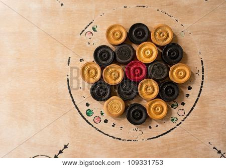 Carrom men pieces arranged on a board