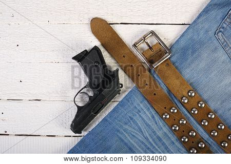 Planks, Phone, Lighter, Gun, Blue Jeans And Belt