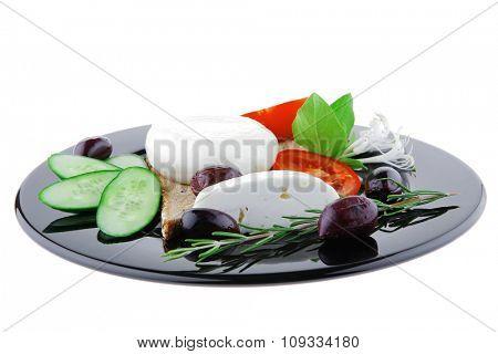 light mozzarella cheese on black dish over white