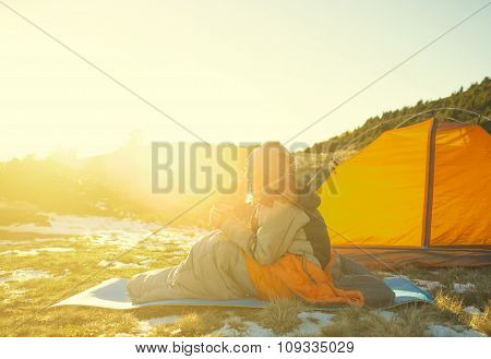 Girl Sitting In A Sleeping Bag.