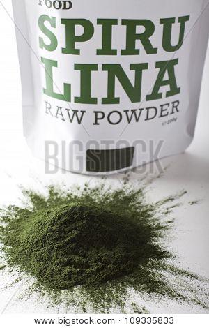 Spirulina raw powder on white background - heap.
