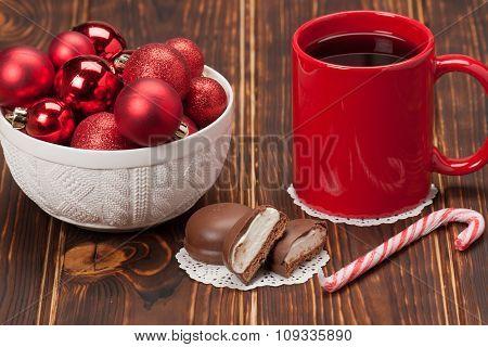 Mug Of Tea Or Coffee. Sweets. Christmas Decorations. Red Balls A