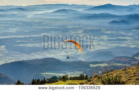 Paraglider Is Flying In The Valley