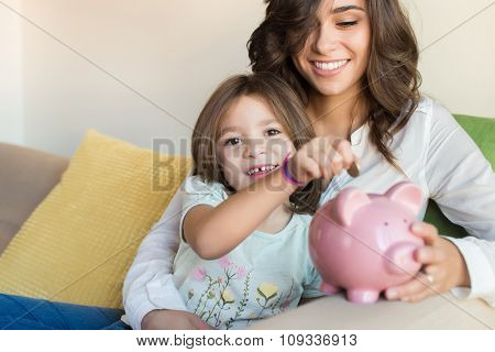 Mom And Daughter Saving Money