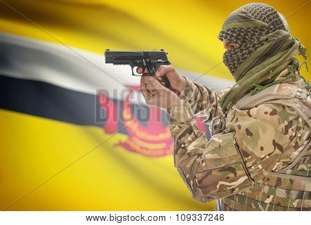 Male In Muslim Keffiyeh With Gun In Hand And National Flag On Background - Brunei