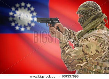 Male In Muslim Keffiyeh With Gun In Hand And National Flag On Background - Burma