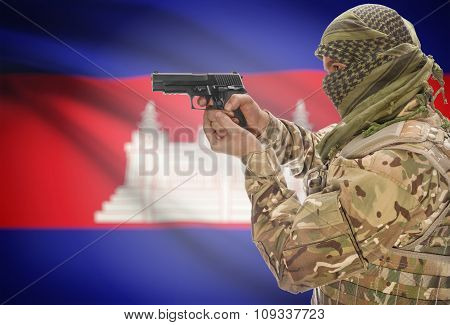 Male In Muslim Keffiyeh With Gun In Hand And National Flag On Background - Cambodia
