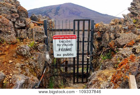 PITON DE LA FOURNAISE, REUNION ISLAND, FRANCE - NOVEMBER 6, 2015: Enclosed gate on hiking path. The Piton de la Fournaise 2632m, Reunion island in the Indian Ocean.