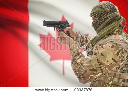 Male In Muslim Keffiyeh With Gun In Hand And National Flag On Background - Canada