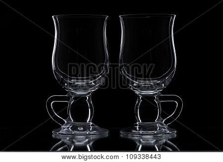 Two Glasses On A Black Background