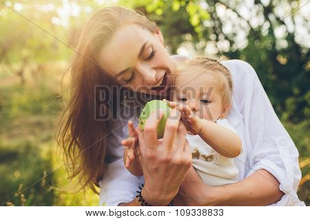 Happy young mother and lovely daughter