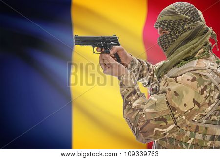 Male In Muslim Keffiyeh With Gun In Hand And National Flag On Background - Chad