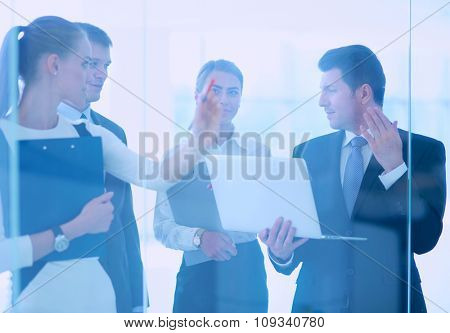 Group of  business people doing presentation with laptop during meeting