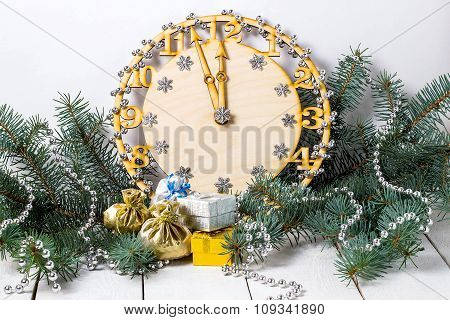 Decorative Clock Showing Midnight In Spruce Branches