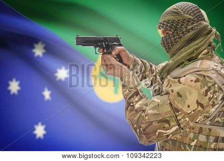 Male In Muslim Keffiyeh With Gun In Hand And National Flag On Background - Christmas Island