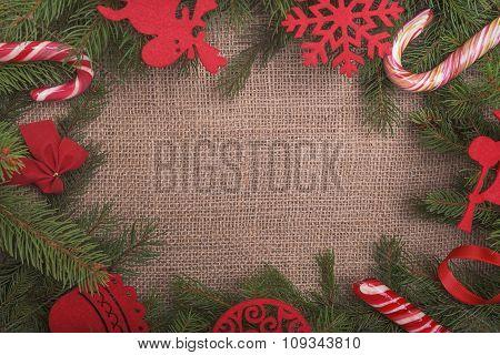 Christmas frame on sackcloth.