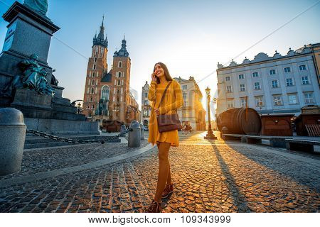 Woman walking in the old city center of Krakow